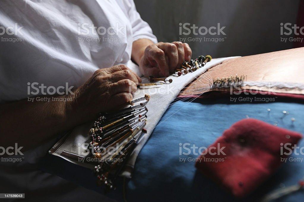 Bobbin lace making stock photo