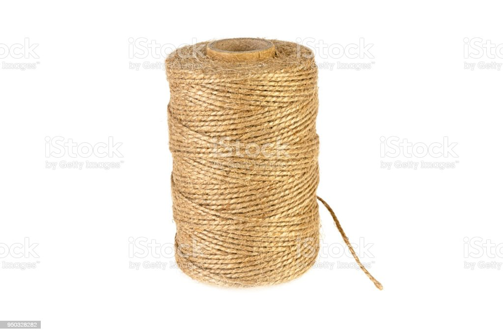 bobbin with a rope on a white background stock photo