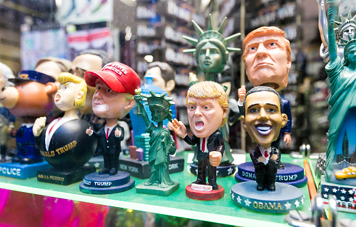 Figurines of contemporary US presidents are displayed in a store window.