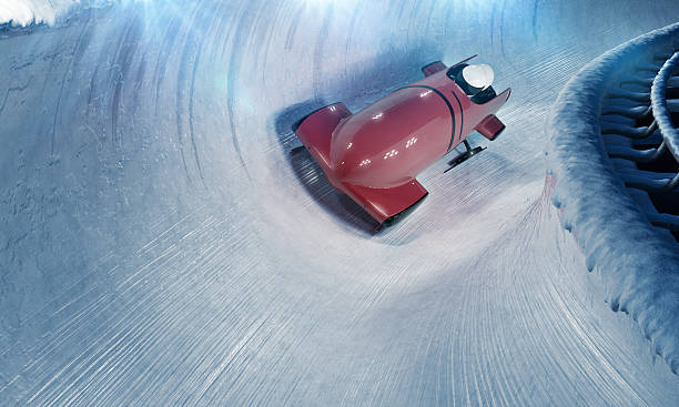 Bobsleigh team at night stock photo