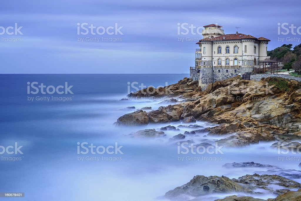 Boccale landmark on cliff rock and sea. Tuscany, Italy. stock photo