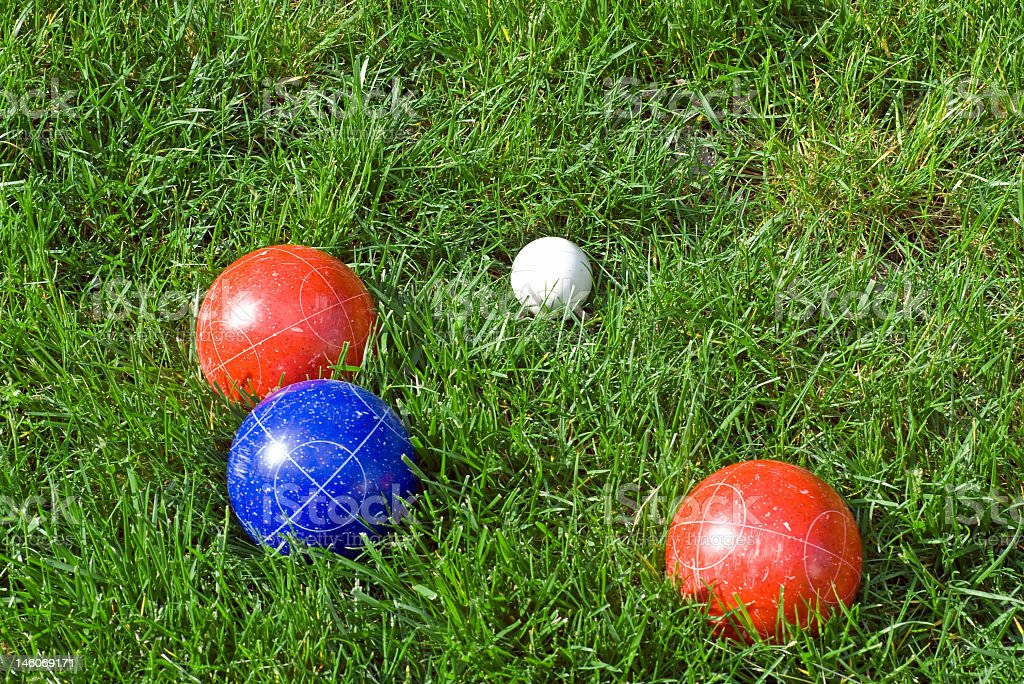 Bocce ball game move on green grass stock photo