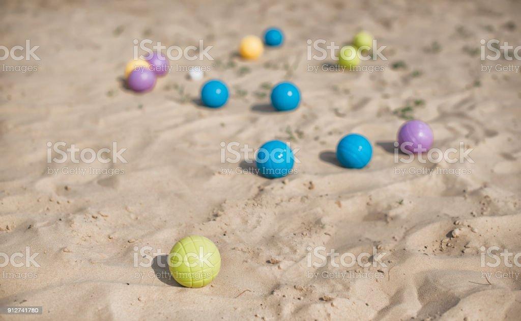Bocce balls on a beach stock photo