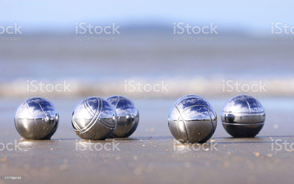 Bocce balls on a sandy beach royalty-free stock photo