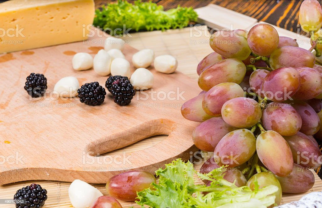 Bocconcini and Blackberries on Cheese Board stock photo