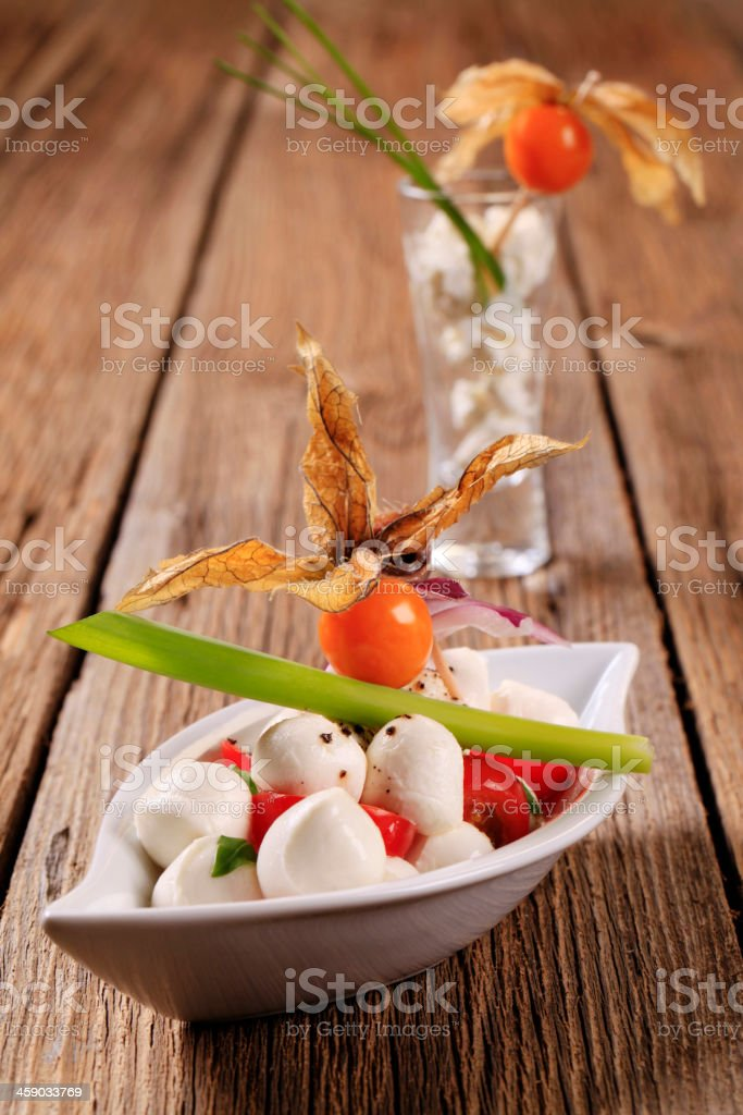 Bocconcini with tomatoes stock photo