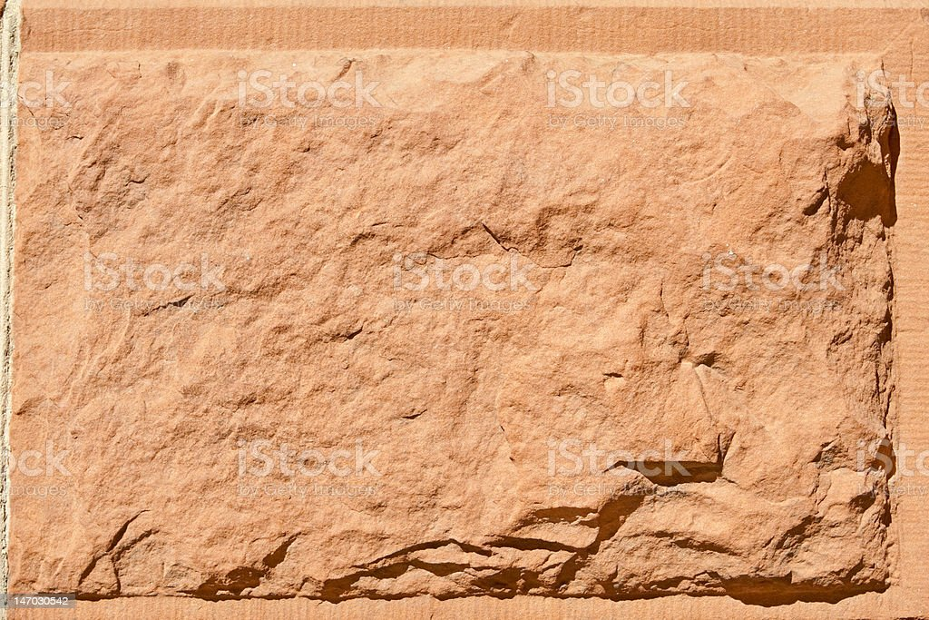Bock of Rustic Rough Cut Red Sandstone Stone stock photo