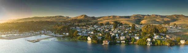 Bodega Bay Houses and Marina at Dusk - Aerial Panorama Aerial panorama of Bodega Bay, California at sunset. sonoma stock pictures, royalty-free photos & images