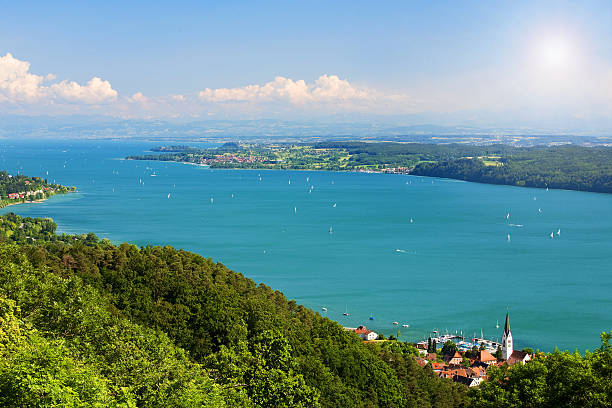 Bodensee lake with lush foliage View on Lake Constance Bodensee with blue sky and the Alps in background Bodensee stock pictures, royalty-free photos & images