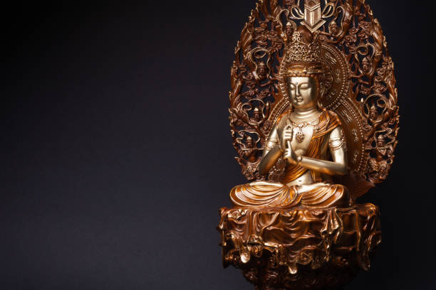 Bodhisattva Guan Yin sitting in the lotus position. Statue of Bodhisattva Guan Yin (Avalokiteshvara) made of bronze sitting in the lotus position, having put hands in knowledge-mudra. bodhisattva stock pictures, royalty-free photos & images