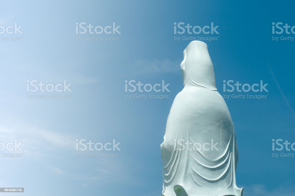 Bodhisattva statue in sky background royalty-free stock photo