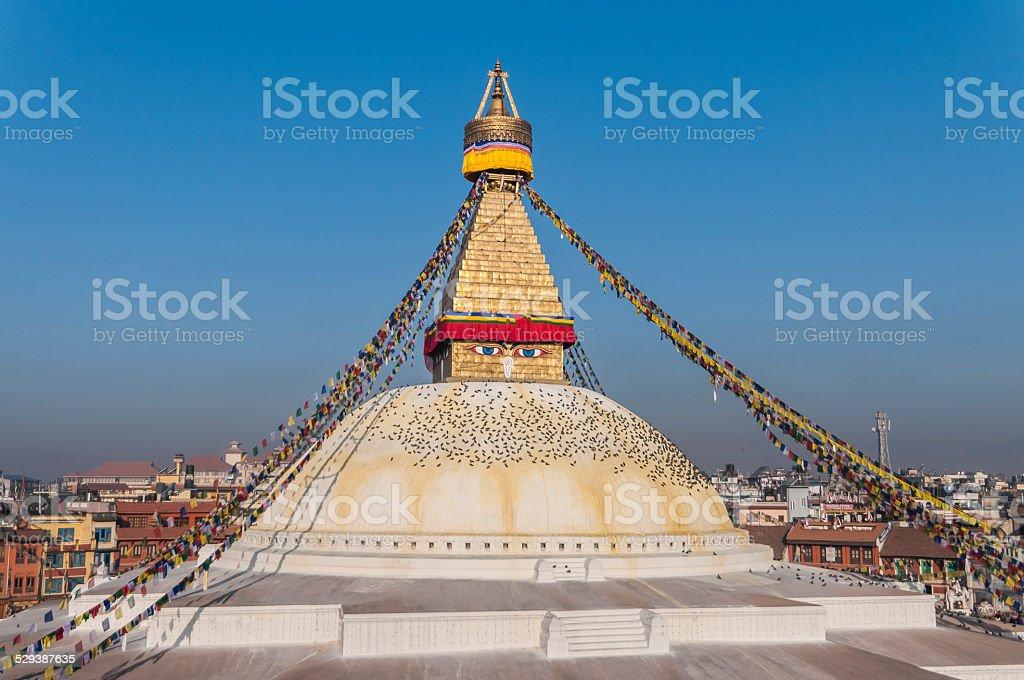 Bodhnath Stupa with Prayer Flags and Surrounding Buildings, Kathmandu, Nepal stock photo