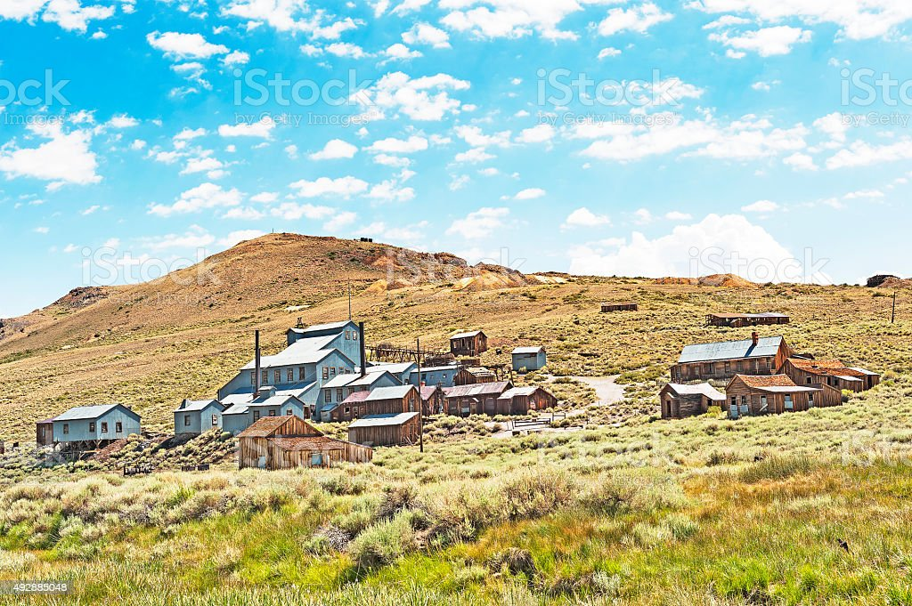 Bodie Ghost Town and Gold Mine buildings on Hillside stock photo