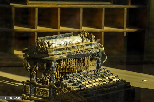 Bodie State Historic Park in California on April 03, 2015: Antique typewriter located in the postal office of the preserved historic ghost town of Bodie in California