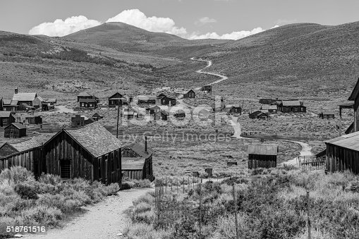Bodie wild west ghost town at Bodie State Historic park in California's Sierra Nevada Mountains in black and white.