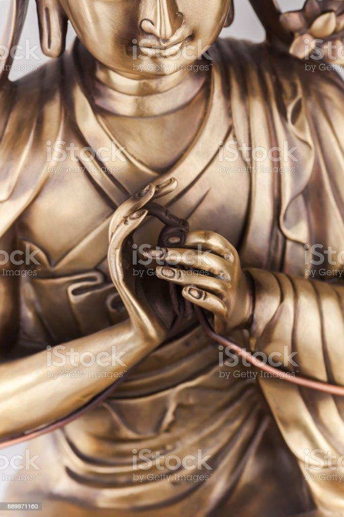 Bodkhisattva Avalokiteshvara sits in a pose of meditation. stock photo