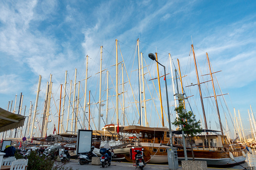 Bodrum, Turkey - December 10, 2019; Iskele Meydanı; Plaza of Pier, boats moored at Bodrum harbor. Mugla, Turkey