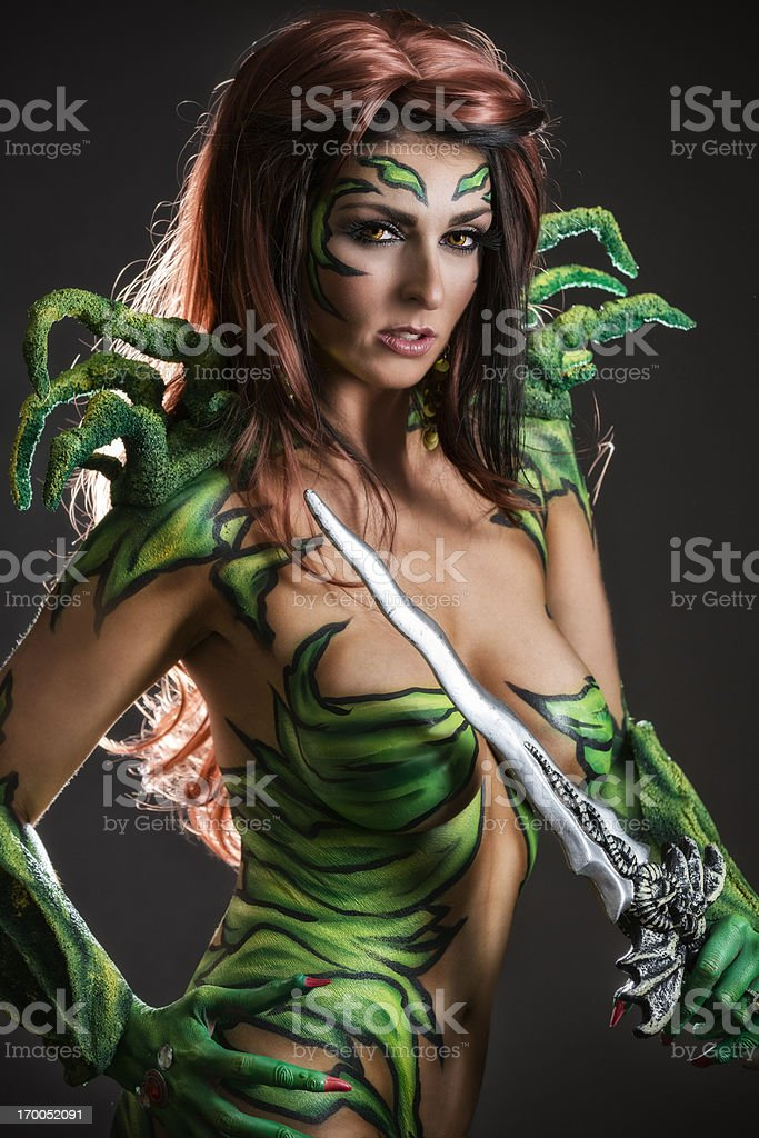 Body art: Alien goddess with sword royalty-free stock photo