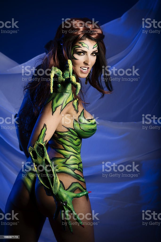 Body art: angry alien creature with sharp claws stock photo