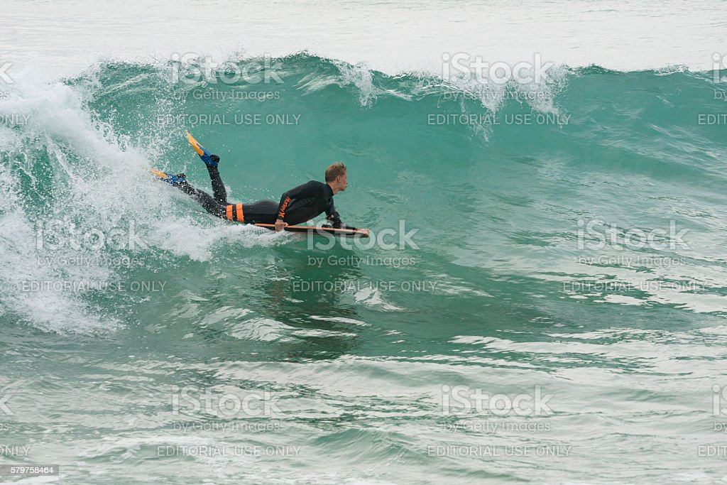 Body board Surfer riding wave at Fistral Beach, Newquay, Cornwall stock photo