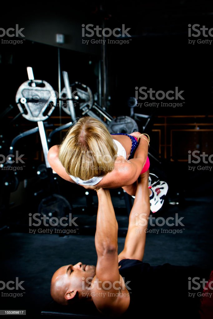 Body Builder BenchPressing A Fit Woman royalty-free stock photo