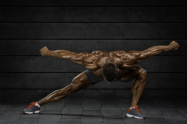 Body Builder Flexing Muscles stock photo