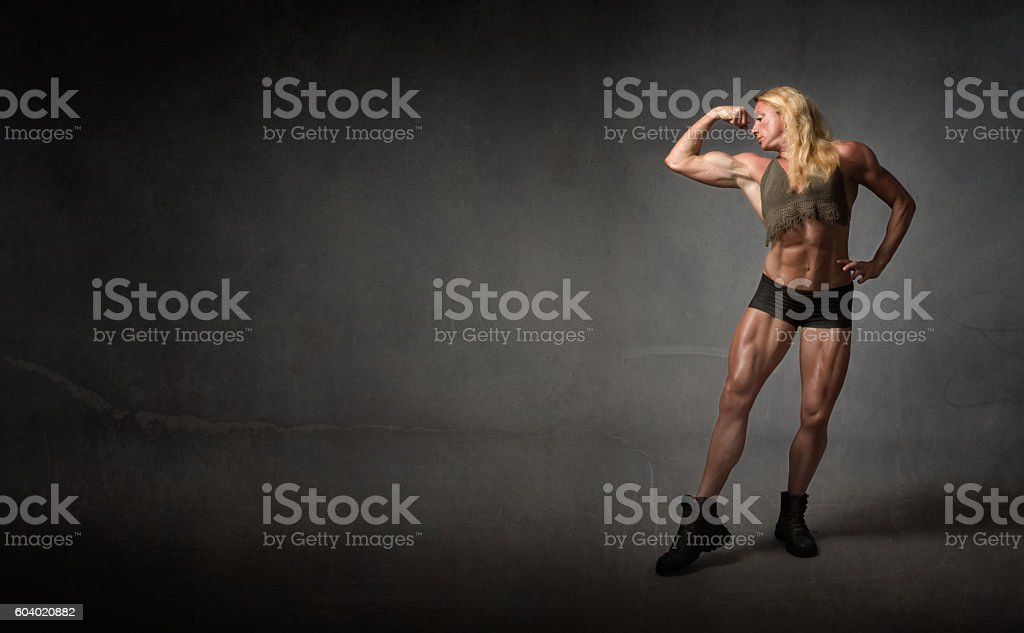body builder showing biceps - Photo