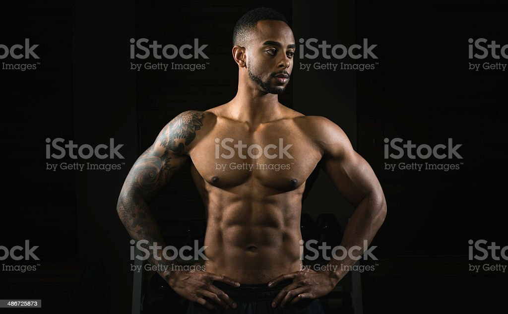 Body Builder Showing Off Physique In Portrait At Gym stock photo
