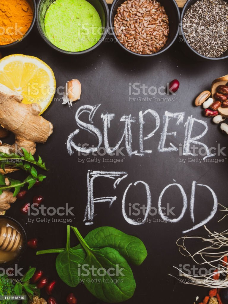 High dietary fibre health food concept with fruit, vegetables, berry,...
