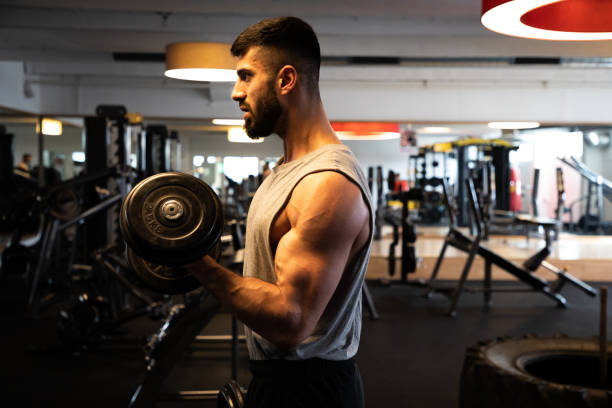 Body Building Workout Men's Fitness Exercise With Hand Weights stock photo