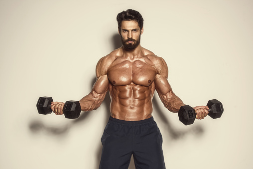 Handsome Muscular Men Exercise at the Gym
