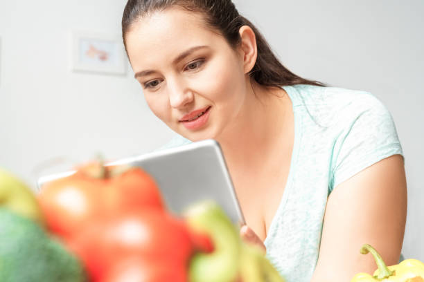 Body care chubby girl leaning on table with vegetables in kitchen picture id1188759482?b=1&k=6&m=1188759482&s=612x612&w=0&h= drkzmayv81m4hkqqp7 9iultfg7zuszkqkvovgfpku=