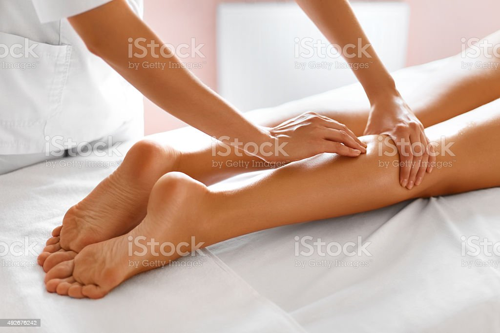 Body Care. Close-up of Woman getting Spa Treatment. Legs Massage stock photo