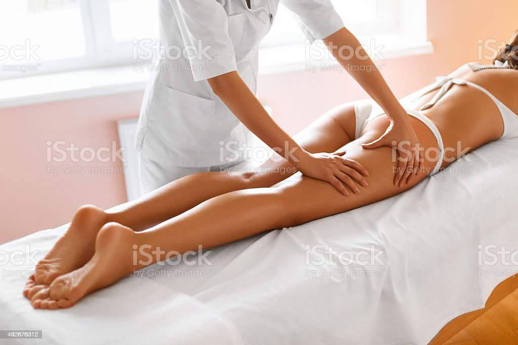 Body Care. Legs Massage in Spa Salon stock photo