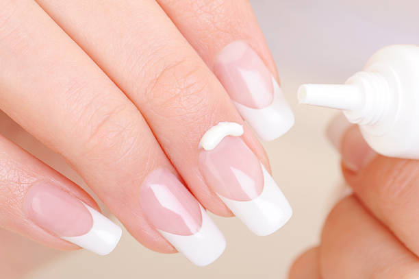 body care of female fingernail and cuticle - cuticle stock pictures, royalty-free photos & images