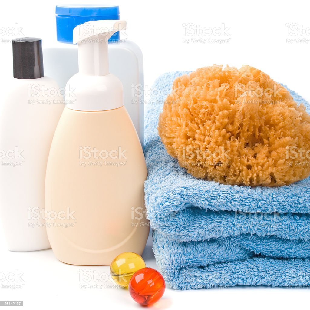 body care products and towel royalty-free stock photo