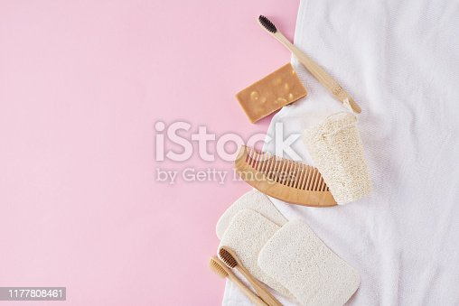 1169442288 istock photo Body care products on a pink background, flat lay top view with copy space. Natural eco friendly zero waste concept 1177808461