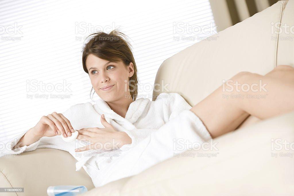 Body care - woman remove nail polish in bathrobe royalty-free stock photo