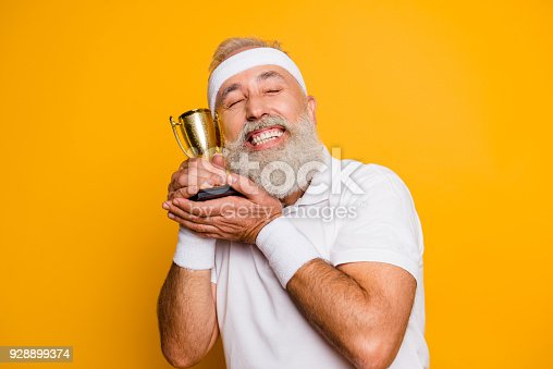 istock Body, health, care, game, coach, challenge, champ, fit, leisure, training, workout lifestyle. Insane infantil emotional cool grandpa with reward, sign of respect, hero, strength, power 928899374