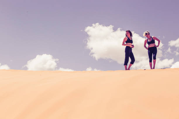 body health fitness on sand dunes with copy space - katiedobies stock pictures, royalty-free photos & images