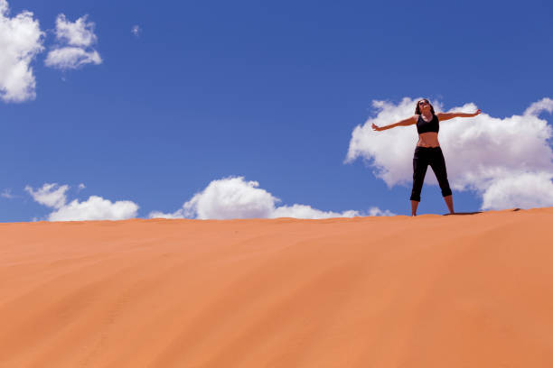 body health stretching yoga fitness on sand dunes - katiedobies stock pictures, royalty-free photos & images