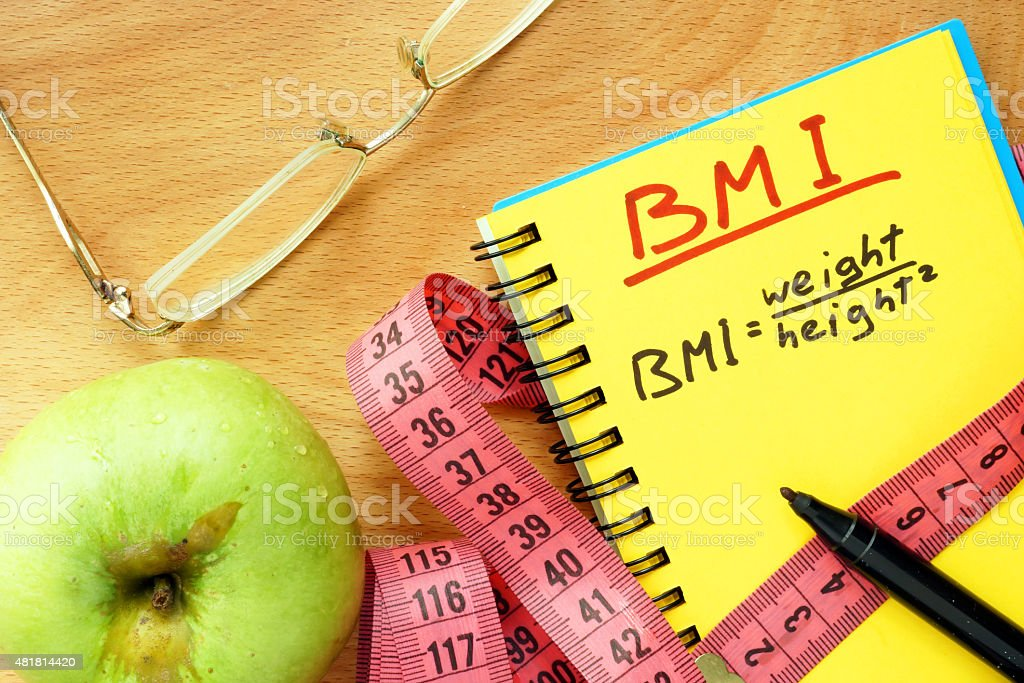 BMI body mass index formula   in a notepad. stock photo