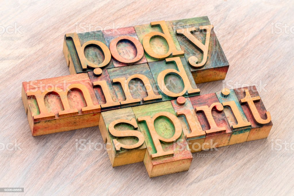 body, mind and spirit word abstract in wood type stock photo