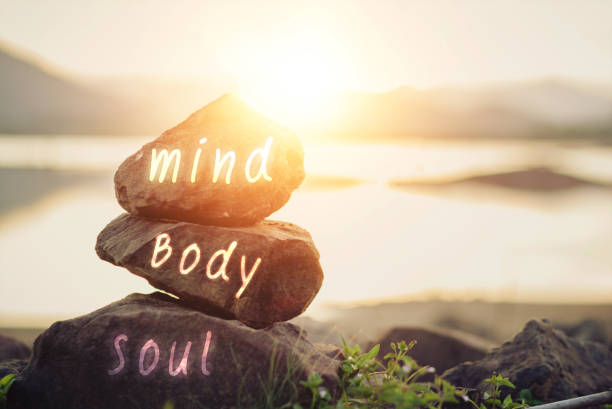 body, mind, soul, spirit Holistic health concept of zen stones / Concept body, mind, soul, spirit wellbeing stock pictures, royalty-free photos & images