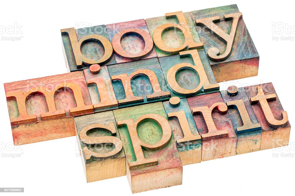 body, mind, spirit concept in wood type stock photo
