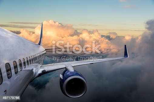 istock Body of an Airplane Flying Above Cloud 497179786