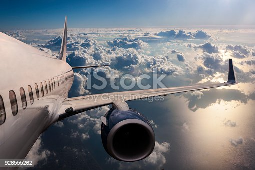 istock Body of an Airplane Flying Through Dark Clouds 926555262