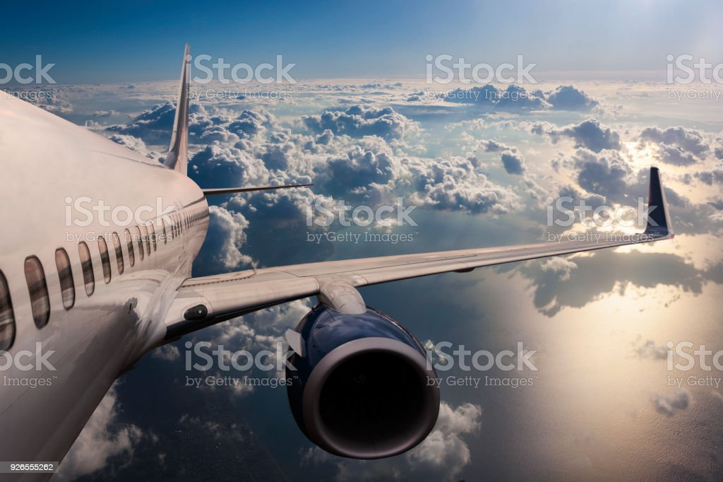 Body of an Airplane Flying Through Dark Clouds stock photo