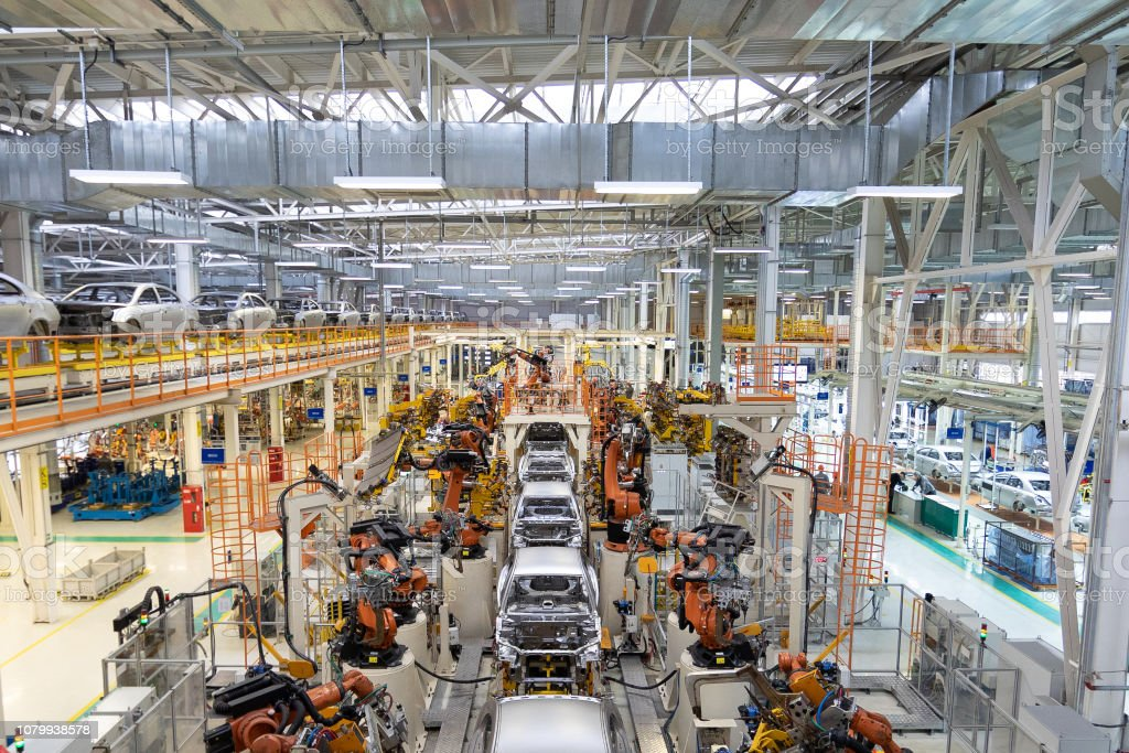 body of car on conveyor Modern Assembly of cars at plant. automated build process of car body body of car on conveyor Modern Assembly of cars at plant. automated build process of car body. Automated Stock Photo