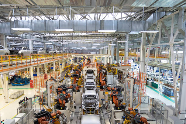 body of car on conveyor Modern Assembly of cars at plant. automated build process of car body stock photo